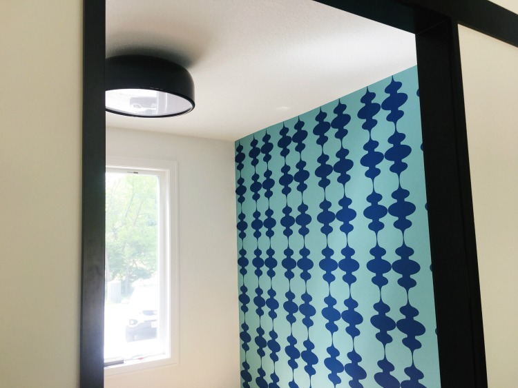 Some Mid Century flair on Shannon's accent wall, featuring our modern  lanterns , shown here in blue. Photo credit: Shannon Crim