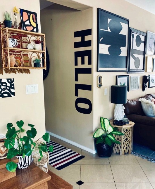 We love how our  HELLO  wall decal ties in with this gallery wall. Photo credit: Jamie Skolnik