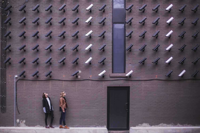 Image Of Security Cameras Looking At People.jpg