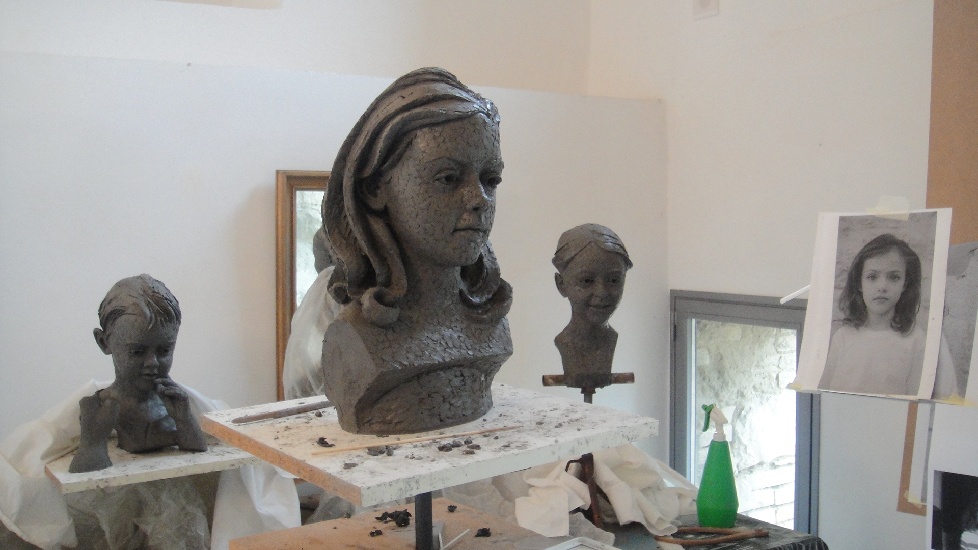 Terracotta sculptures of local children, 2013