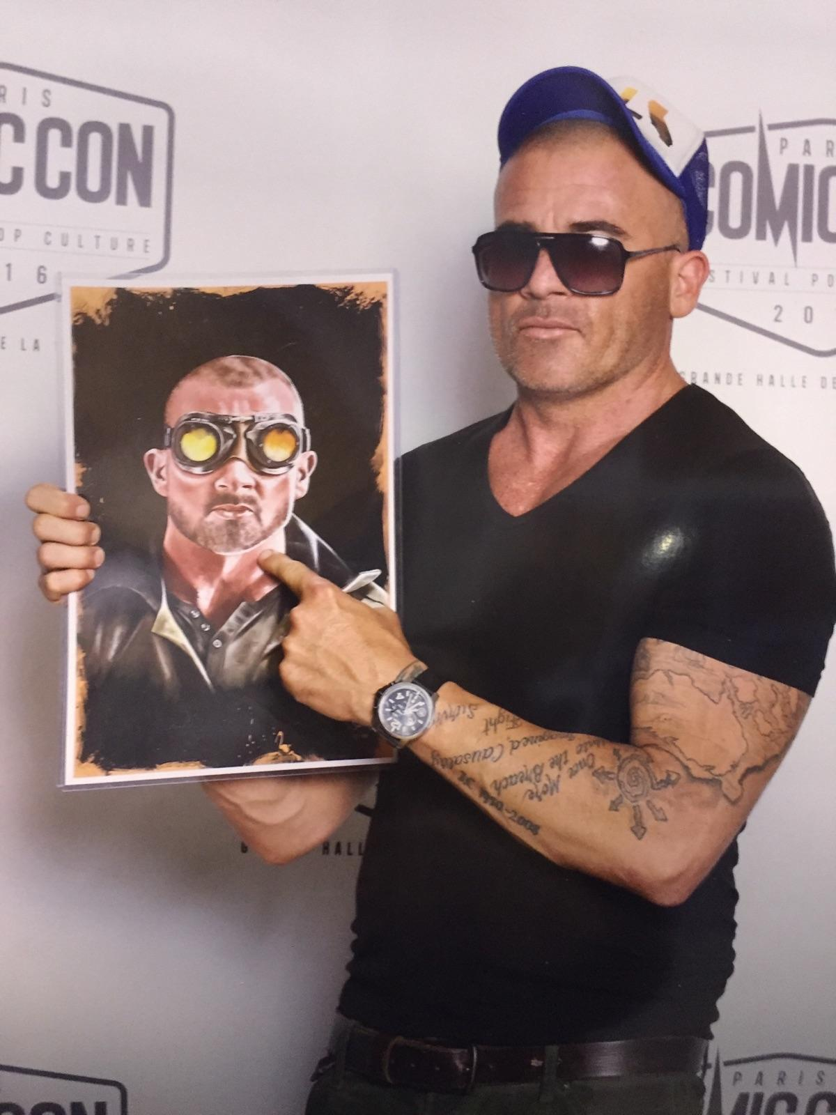 dominic purcell plays heat wave on flash at paris comic con holding my heat wave poster fan art by tony santiago