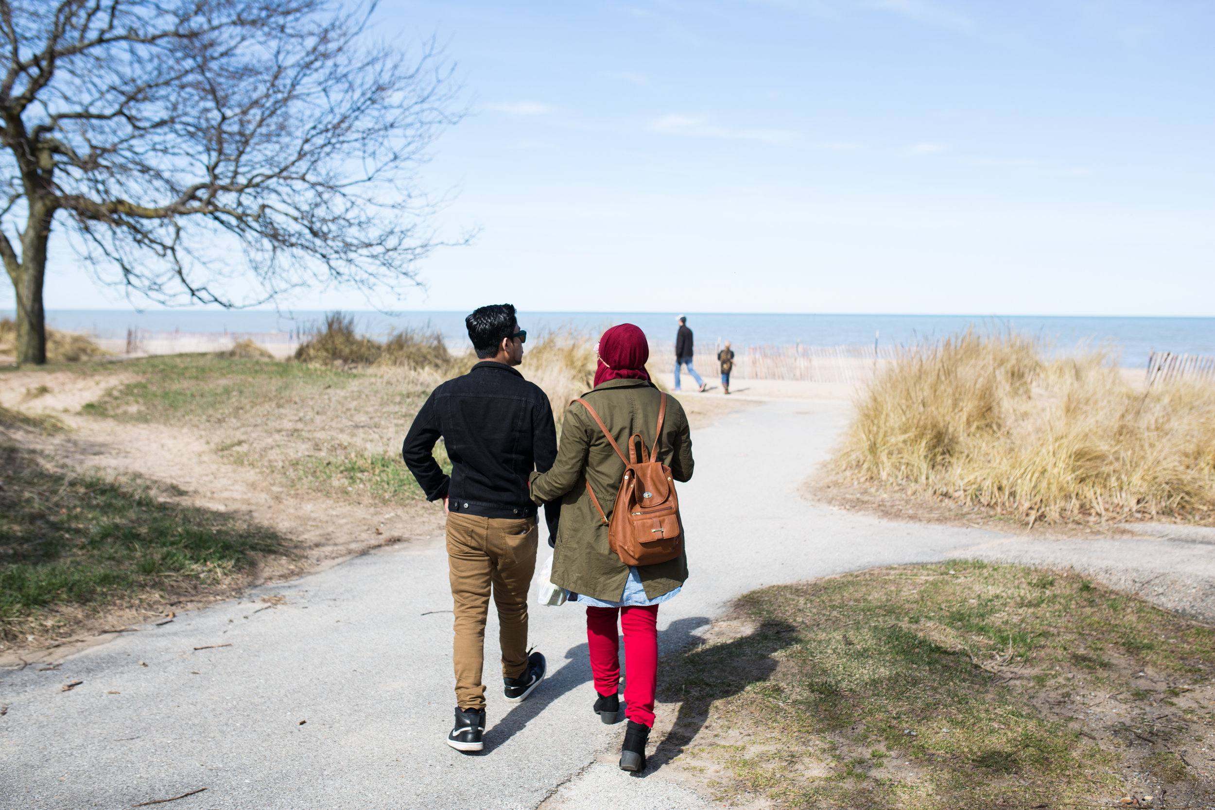 Abdul Samad with his wife, Bibi, 18, on Lake Michigan. They met in the United States in 2016.