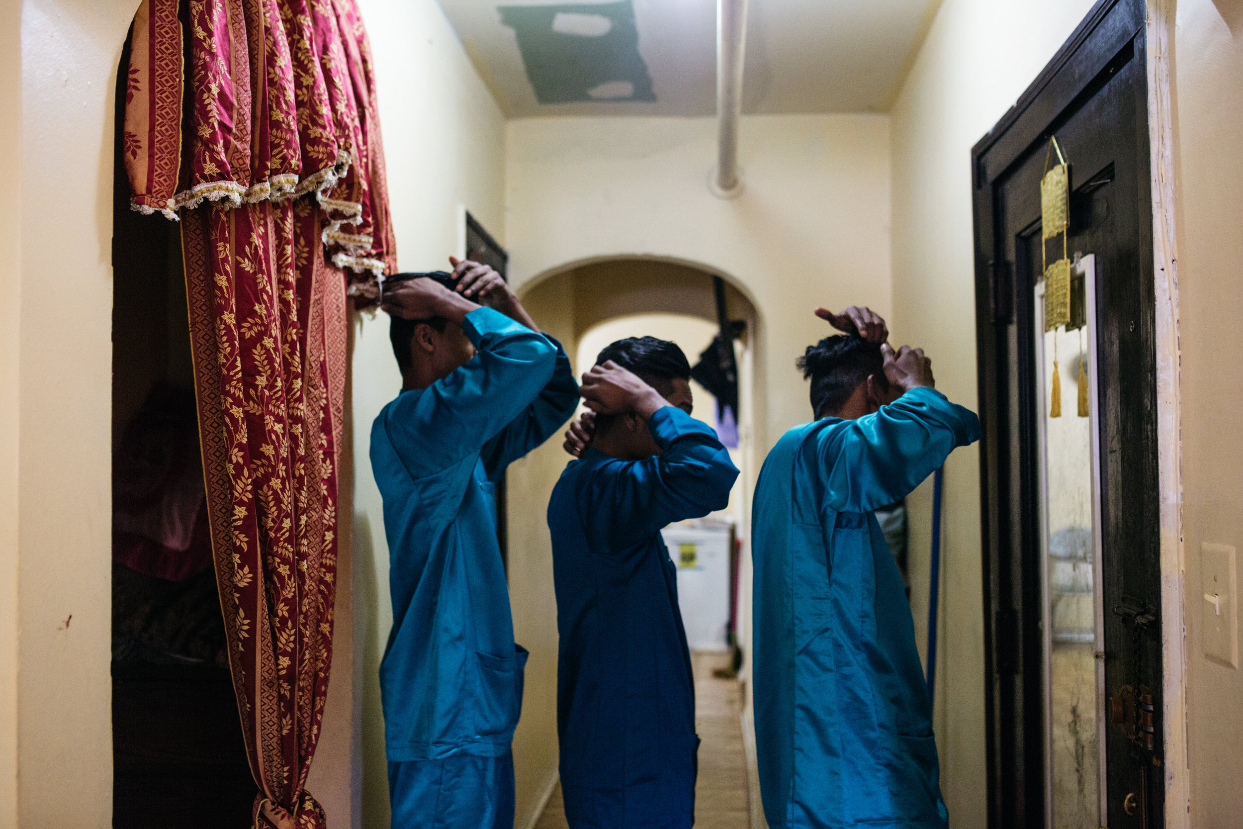 Young men preparing for Eid al-Adha celebrations.     Image