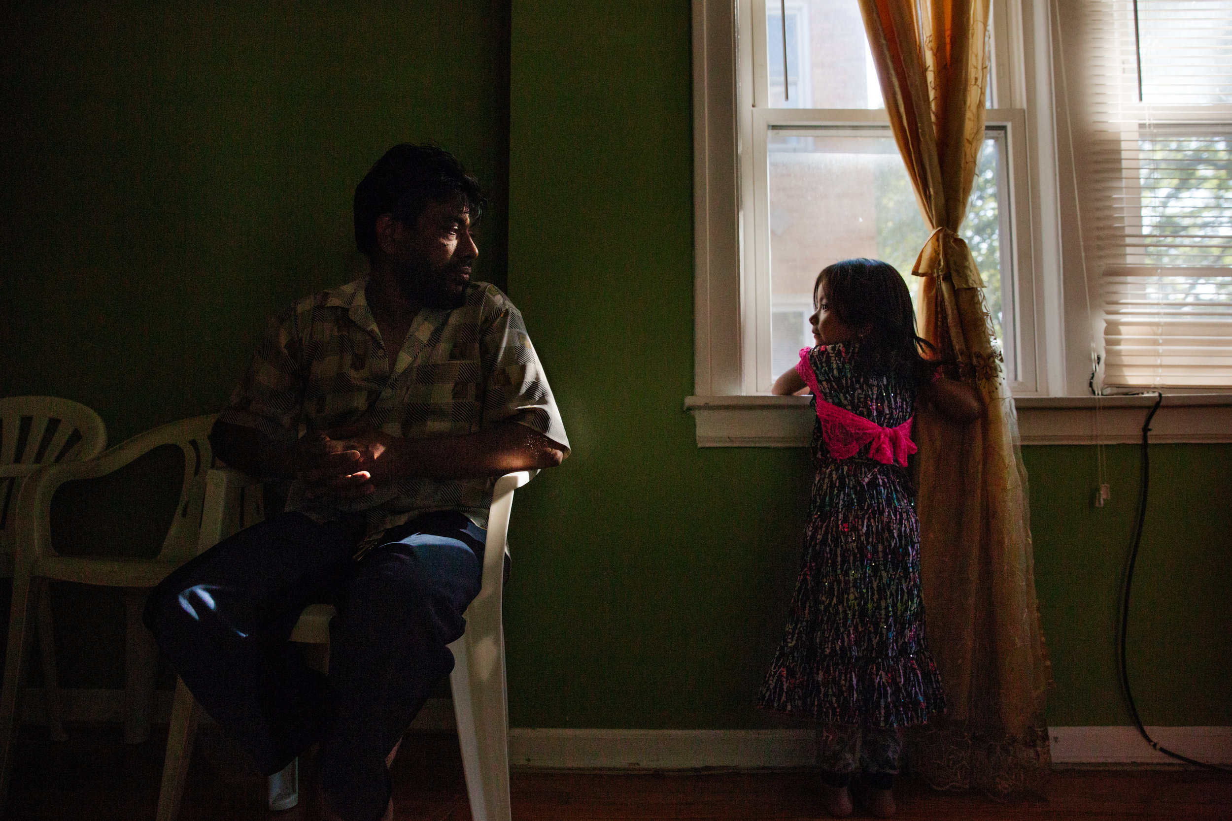 Abdul Aziz, 39, at home in Rogers Park, with his daughter, Arina, 4. As a teenager, he left his family in Myanmar's Rakhine State, where the Rohingya are concentrated, to find safety in Malaysia.