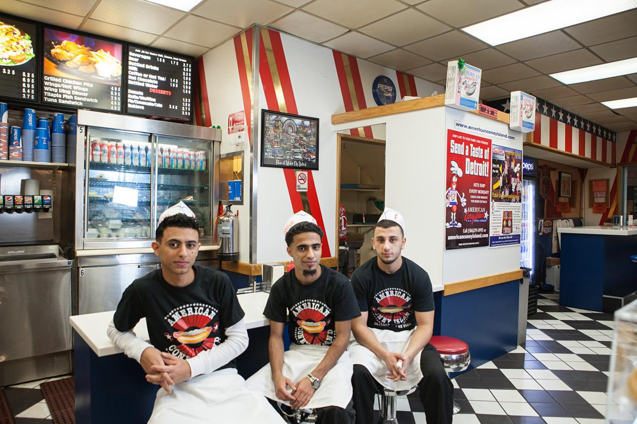 Hamza Haider, Nasa Alsaiadi, and Walid Saker, servers at American Coney Island, downtown Detroit.