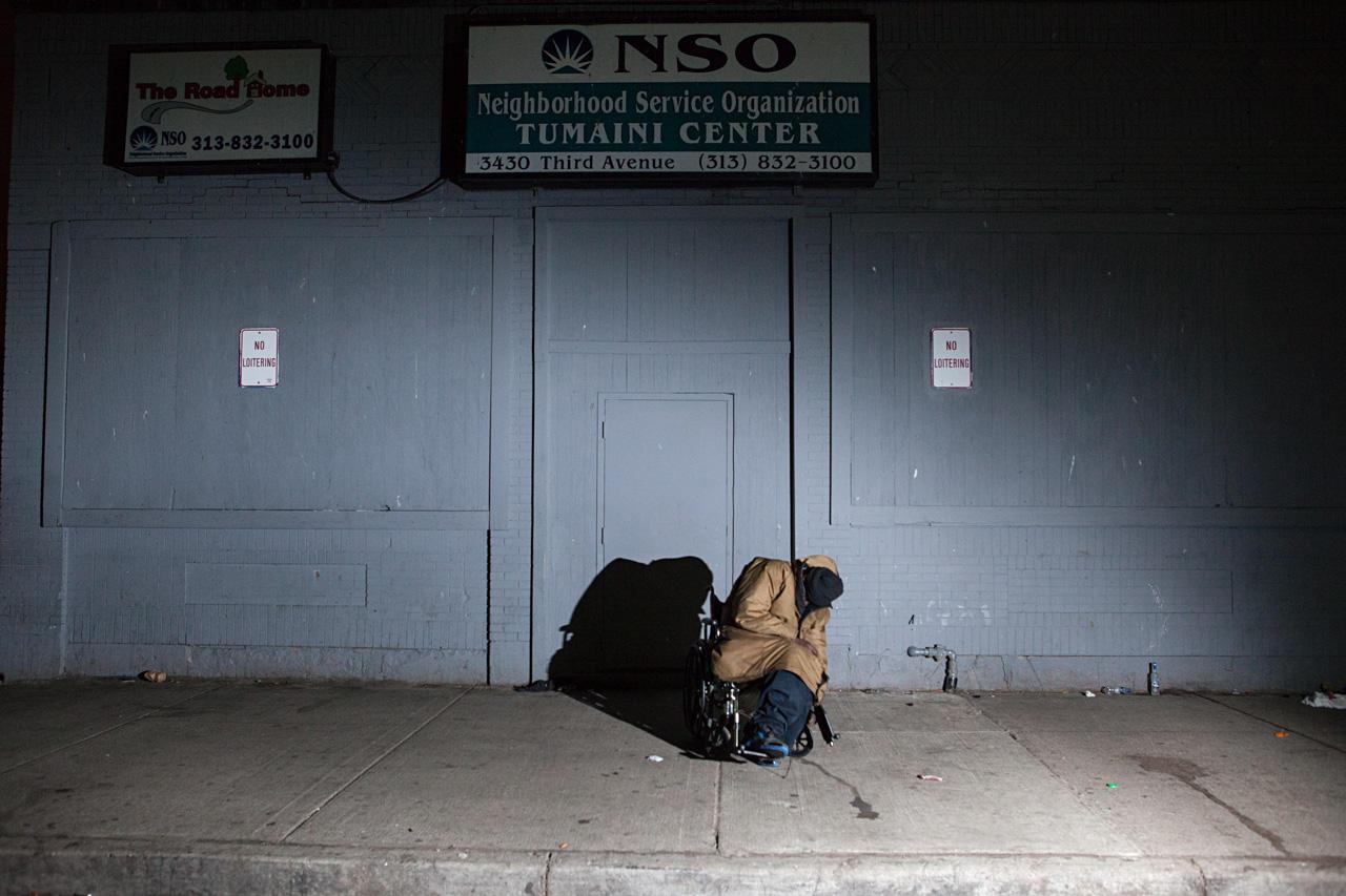 A homeless man sleeps in the Cass Corridor.