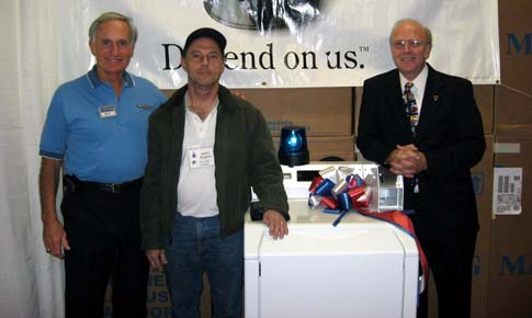 High-Efficiency Washer Winner, James Hedden  (Left to right: Richard LaMaina, James Hedden and Dennis W. Waters)