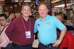 Equipment Marketers Sales ManagerLarry LaMaina chats with one of themany exhibitors at the trade show