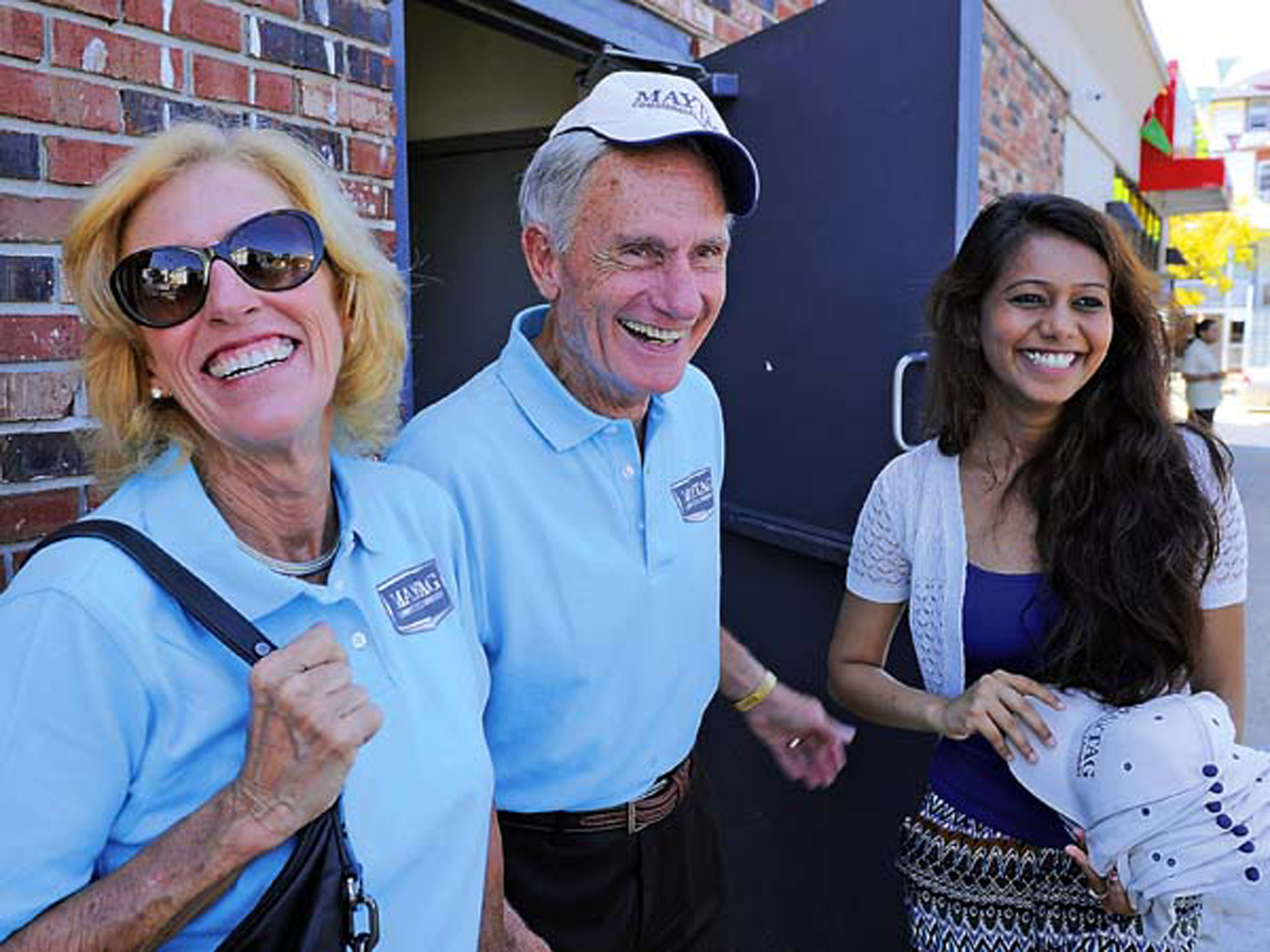 Dick and Sue LaMaina, 72 and 69, owners of the third generation Maytag commercial laundry equipment distribution company, Cherry Hill-based Equipment Marketers, talk with Alpa Patel (right) the wife of one of the owner partners of a new Maytag laundromat during the grand opening in Atlantic City August 27, 2014. ( TOM GRALISH / Staff Photographer )