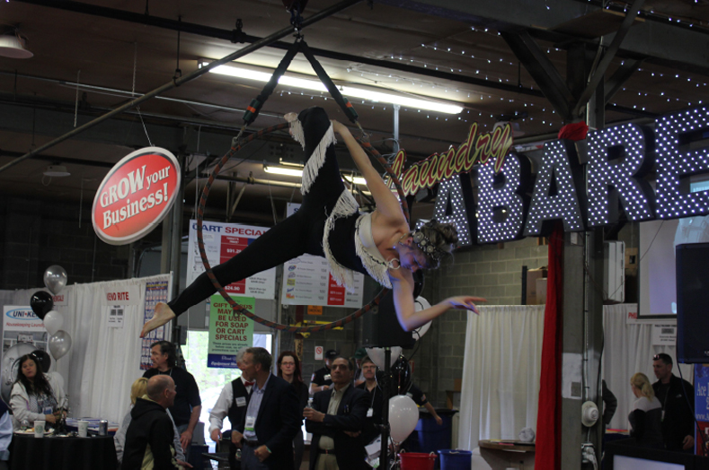 One of many cabaret-themed acts - Amanda Mandaly of Electrocute performing aerial acts above the trade show area.