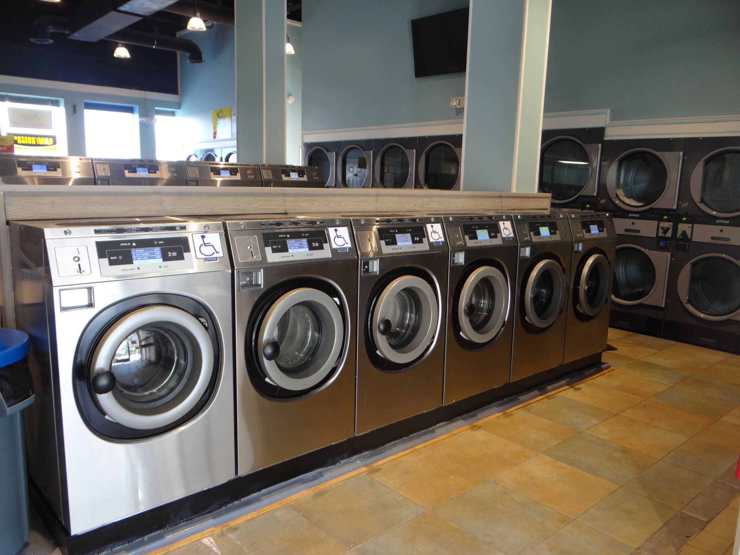 Bernie DiConstantino and George Gautreaux tested Primus laundry equipment in their first Allentown, Pa., store before deciding to open a second that features nothing but Primus equipment (seen here).  (Photos: Equipment Marketers)