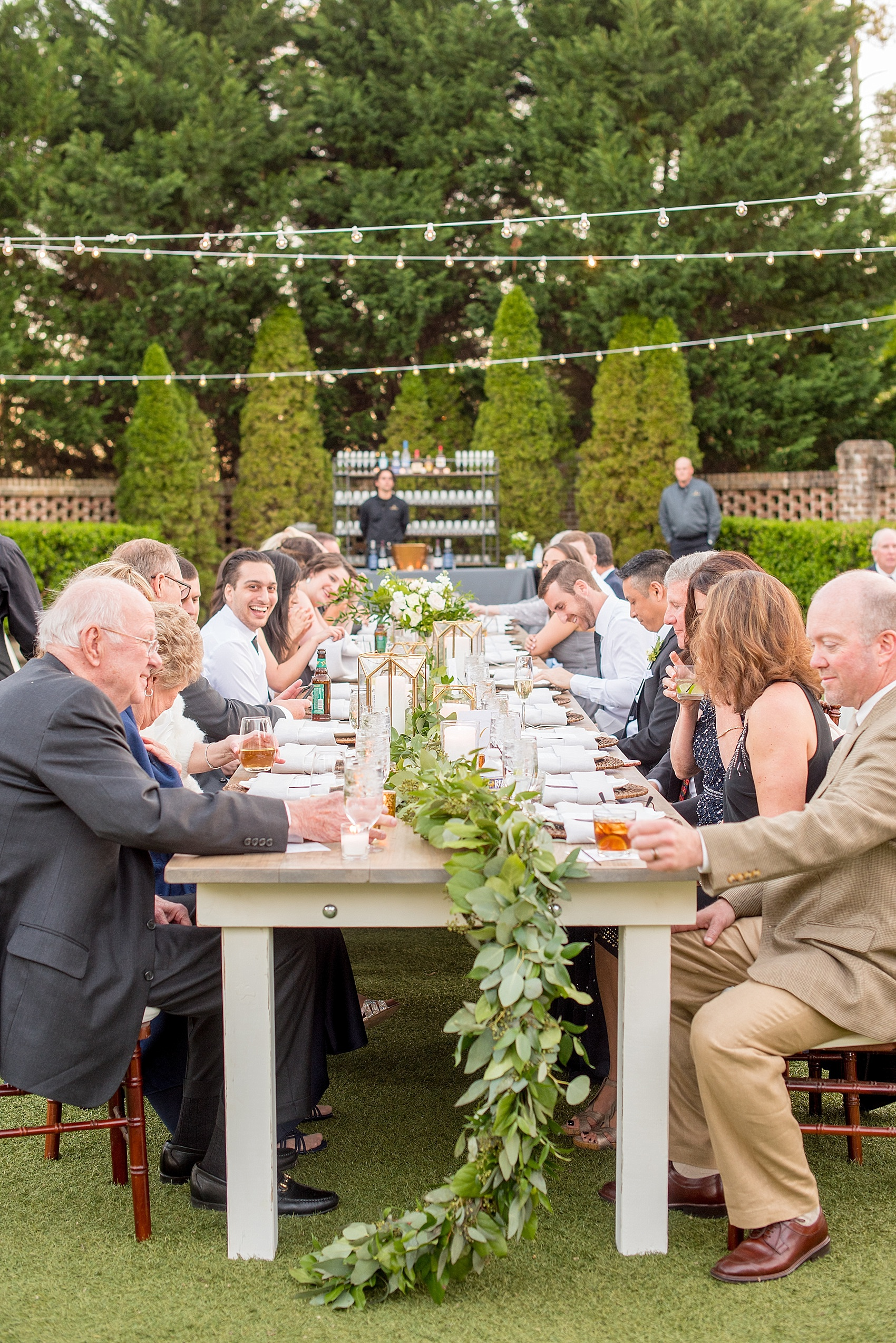 Reception at The Sutherland, Garland on Cottage Luxe Farm Tables