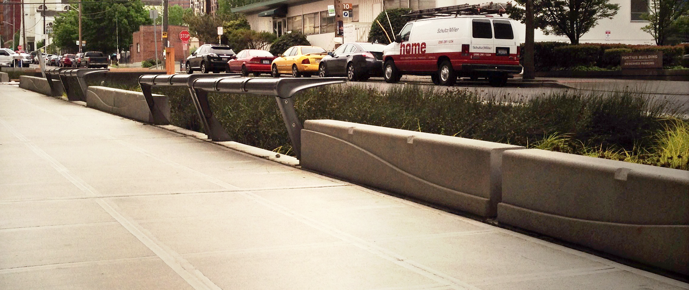 """In contrast, clip """"reliefs"""" are used on these concrete curbs as deterrents. This gives the illusion that both pieces are of one kit of parts:one void, one mass.Nicely done."""