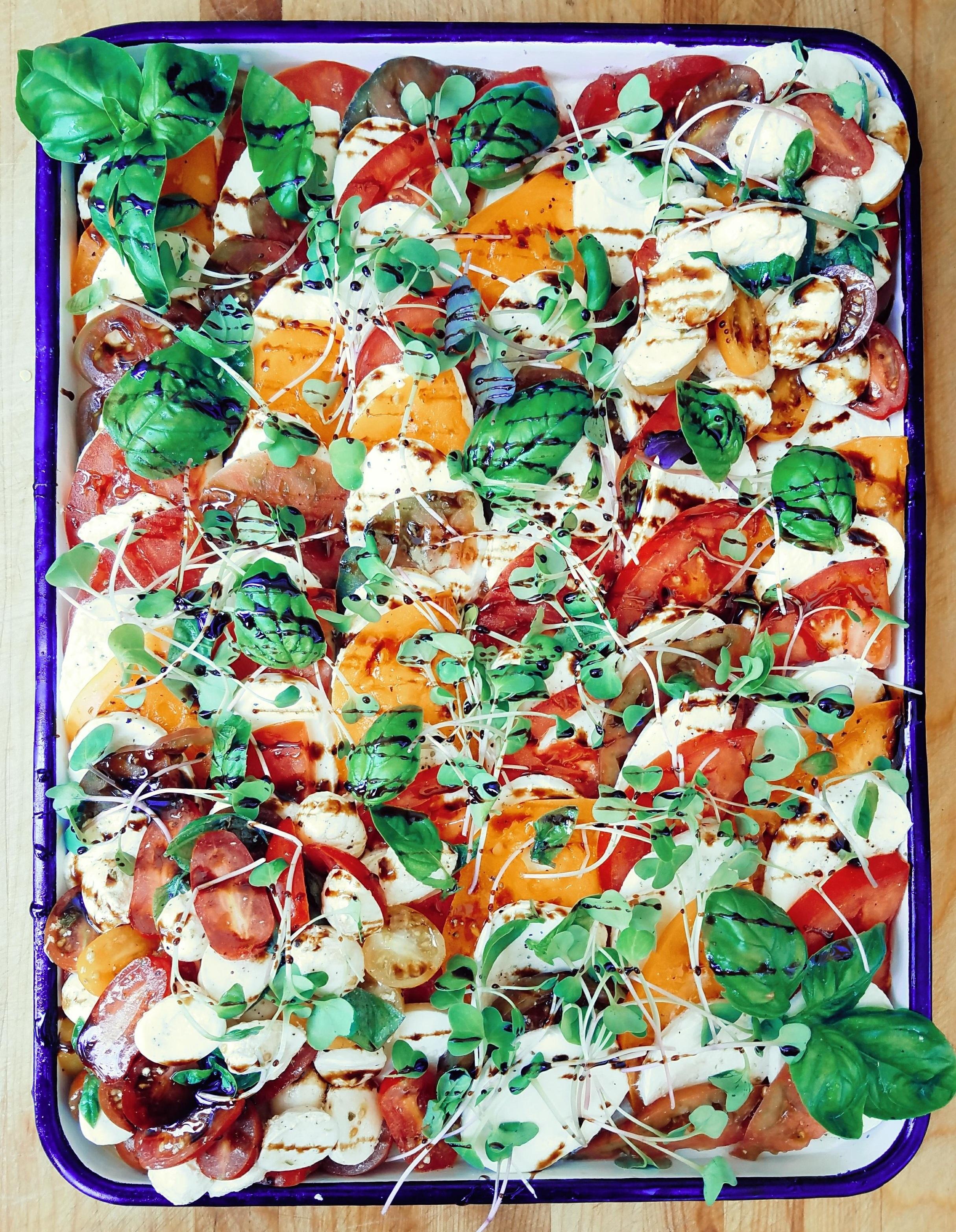 Heirloom Tomato + Mozzarella.    micro greens. basil. xvoo. balsamc reduction.