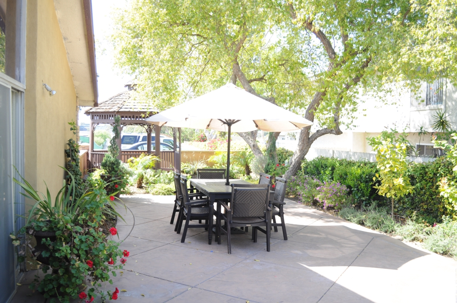Outdoor patio table with umbrella