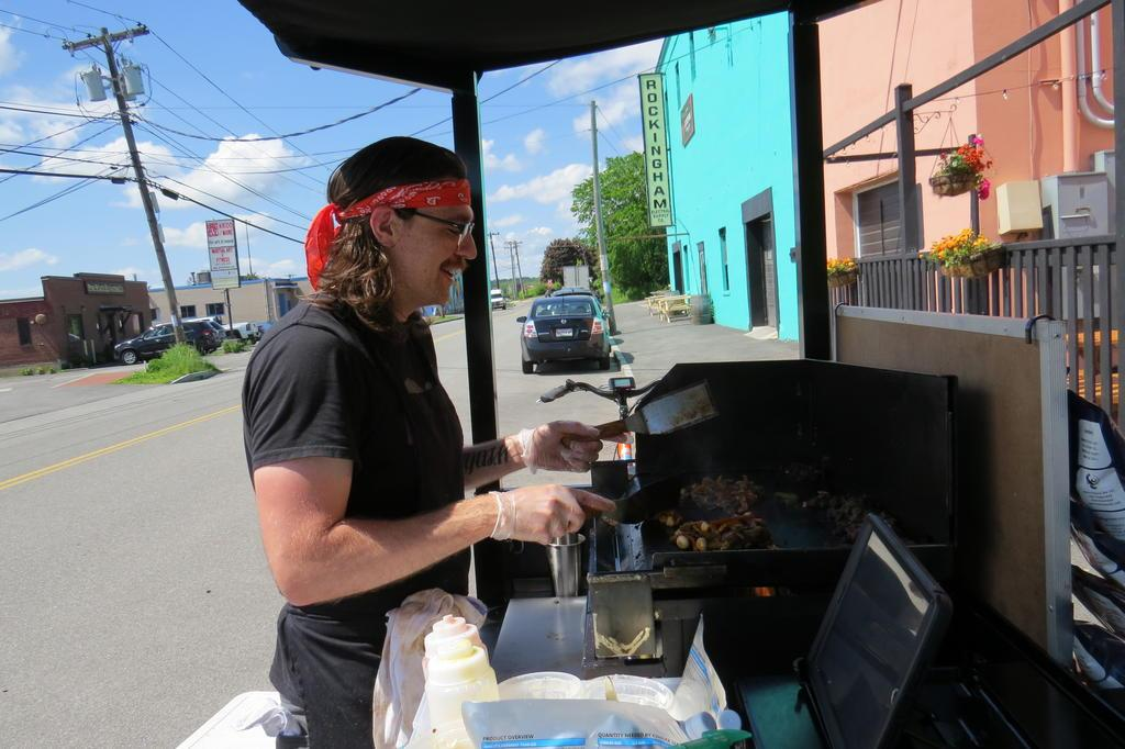 Peter Murphy, owner of Rebel Cheesesteaks, cooks up a vegetarian cheesesteak with smoky mushrooms outside Lone Pine Brewing on Anderson Street on June 6.