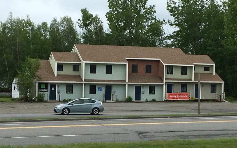 Patric Santerre and Celeste Bard, of Portland's Arcadia designworks, bought 26 Balsam Drive in Millinocket in October, and are moving their office there part-time, as well as renting out space.