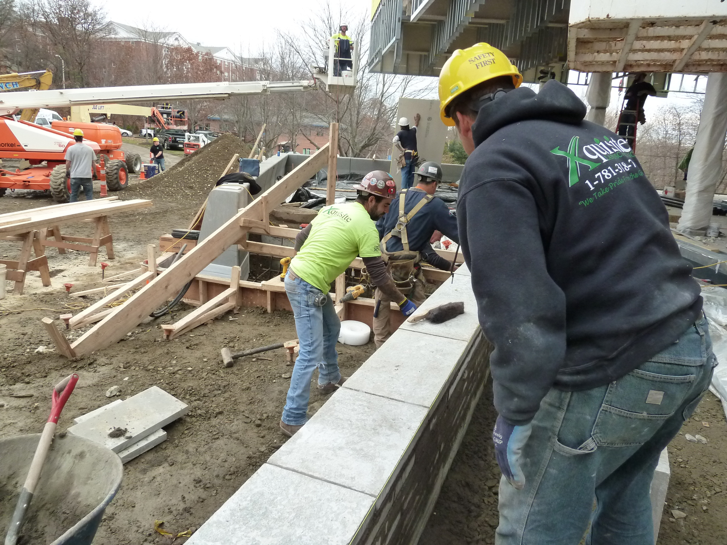 In order to get the building open in the spring, building and site contractors are on the job at the same time.