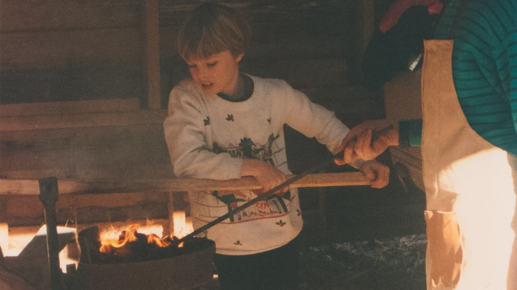 Jacob pumping the bellows of the coal forge for his older brother.