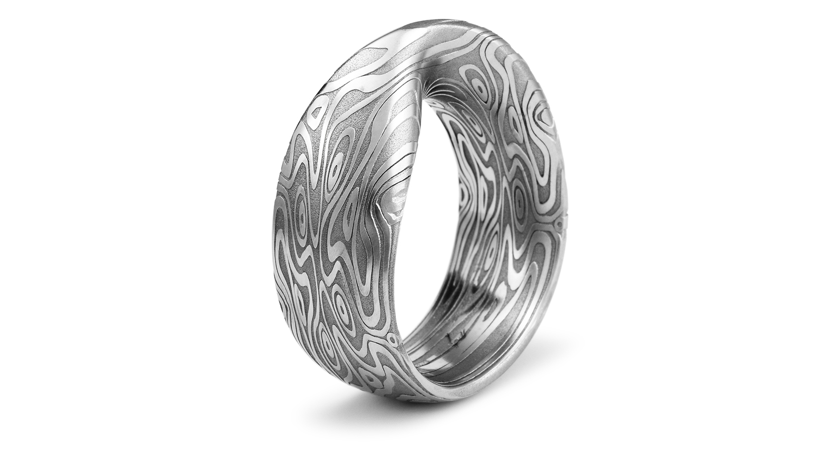 A seamless möbius strip ring custom carved from our Damascus.