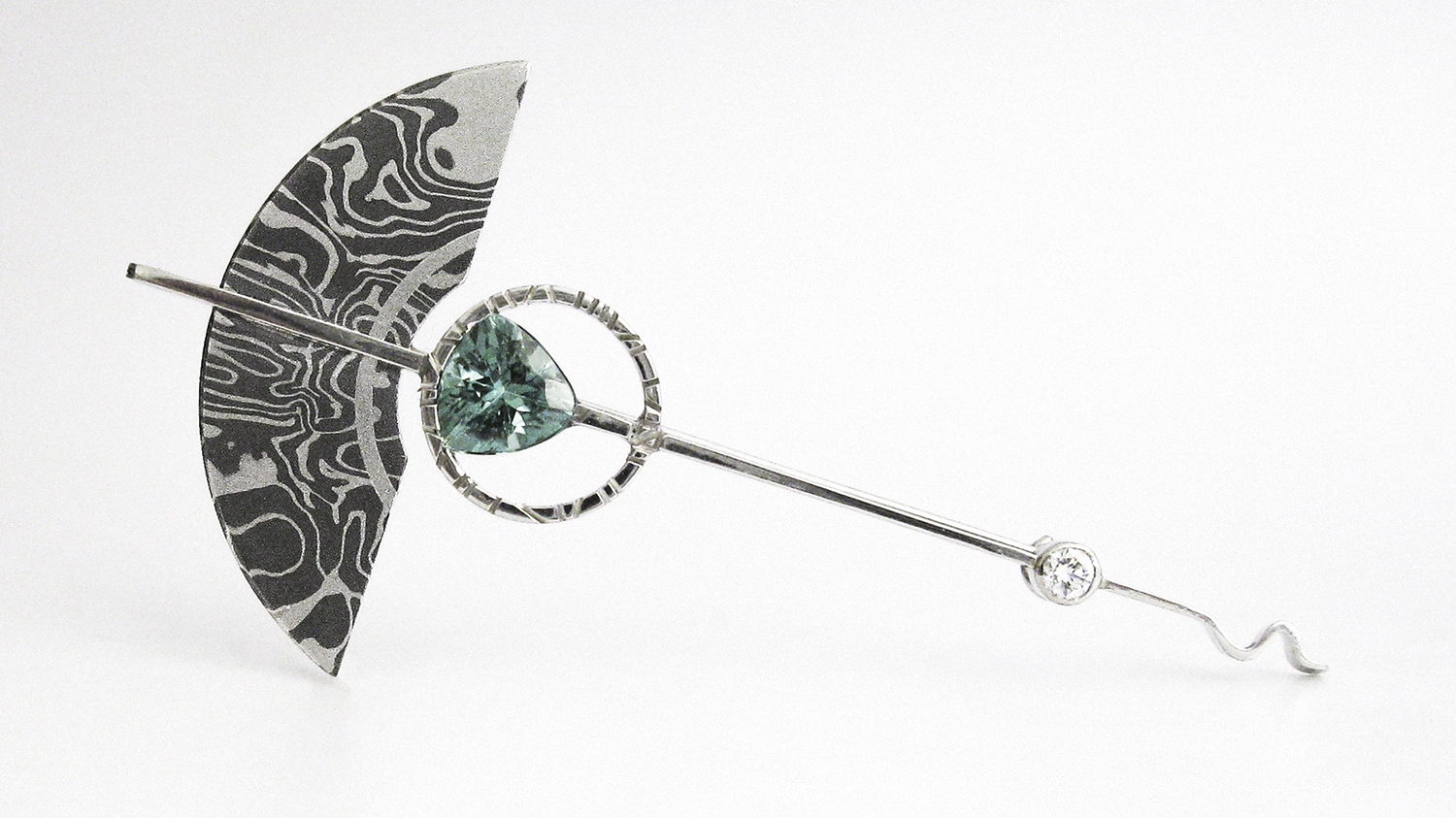 A brooch made from experimental Tantalum and Platinum Mokume Gane.