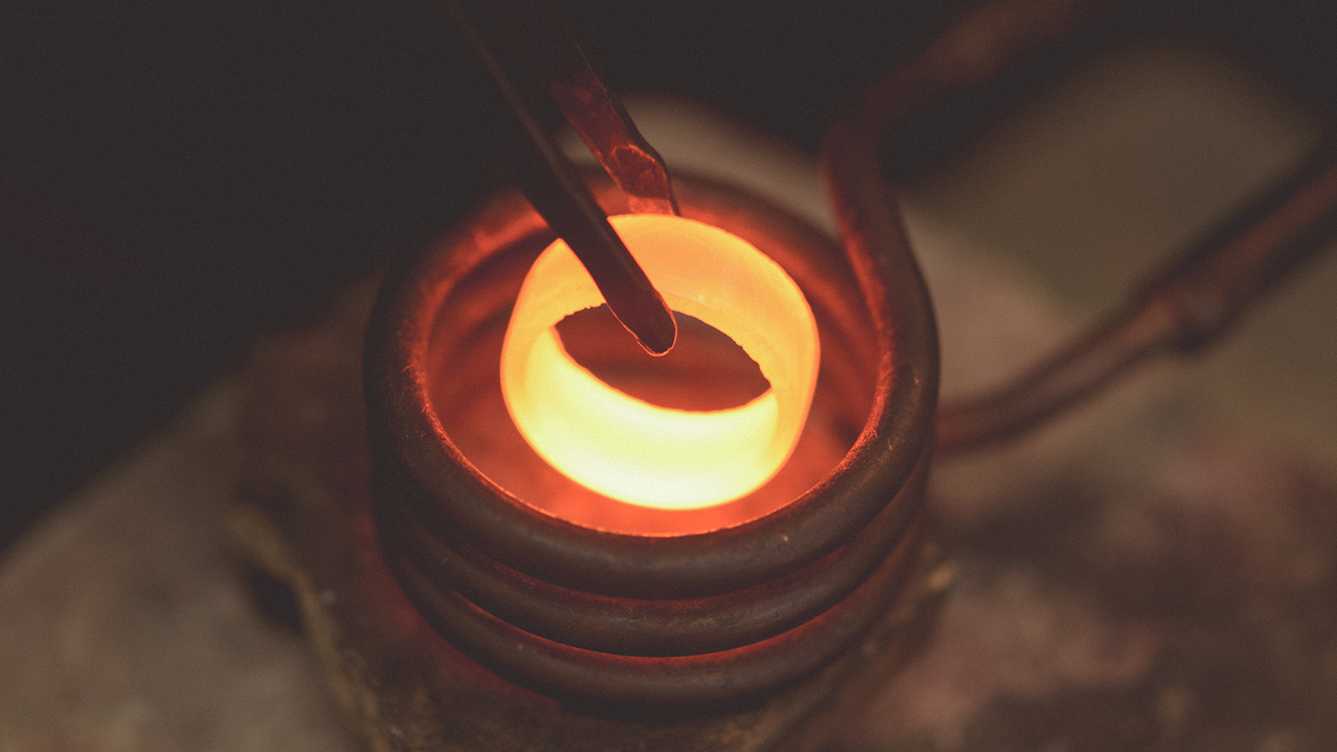 Heat treating a Damascus band to impart maximum corrosion resistance with our induction heater.