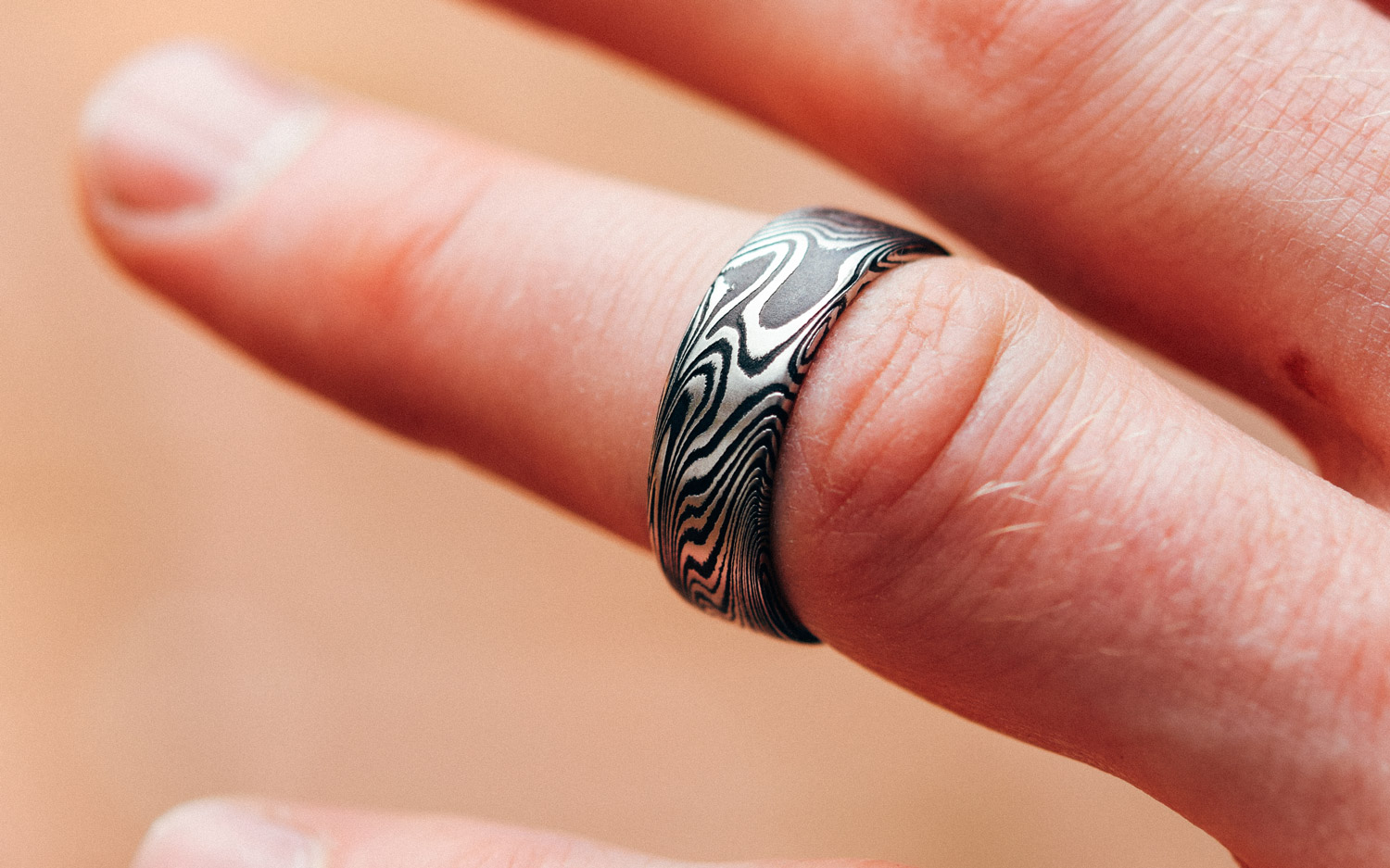 A Damascus Steel Wedding Band should always be sizable since you will wear it for life.