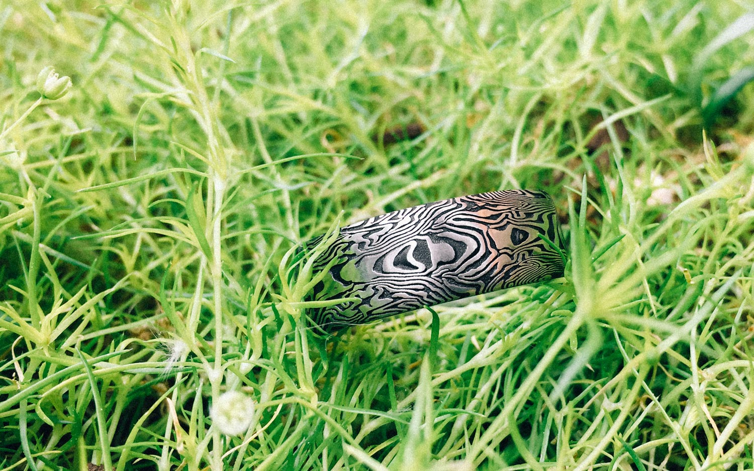 Symmetrical patterned Damascus Steel Ring with Fire Oxide –  BOOKMATCHED