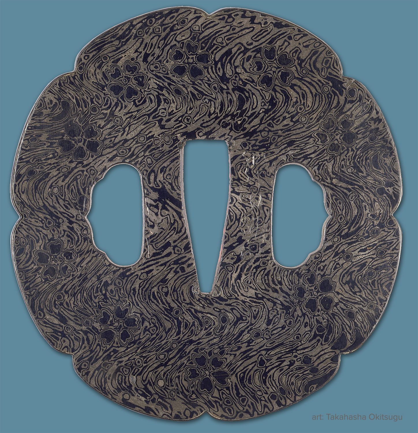 Tsuba by Takahasha Okitsugu. 19th Century. Probably Shibuichi and Shakudo. Pattern depicts plum blossoms floating on water. Courtesy: Museum of Fine Arts, Boston. William Sturgis Bigelow Collection.