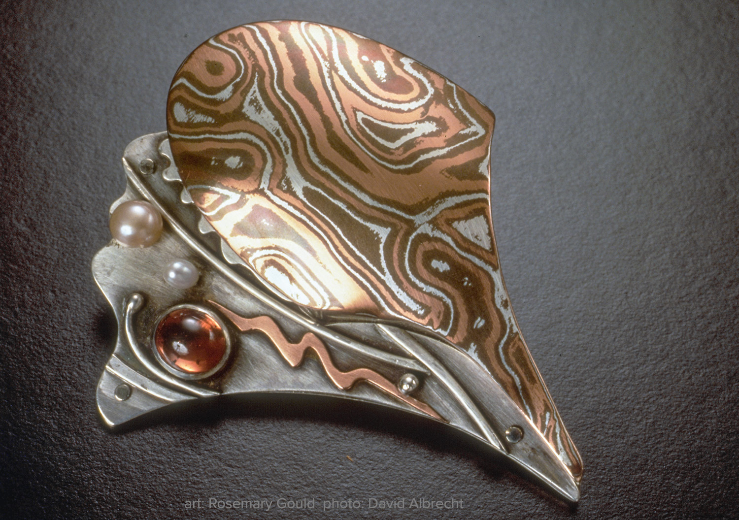 Shell Series Conch Brooch by Rosemary Gould. Shibuichi, copper, and fine silver with pearls and garnet. Photo: David Albrecht