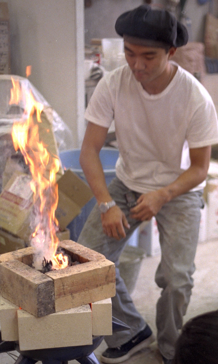 The metal is melted with a reducing flame using a gas-fired forge which is bricked in around the melting crucible.