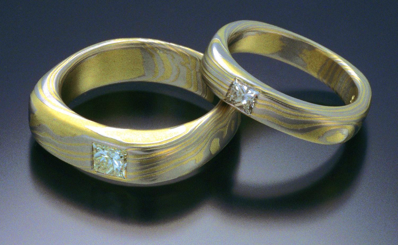 Platinum and 18K diamond wedding rings by Steve Midgett.