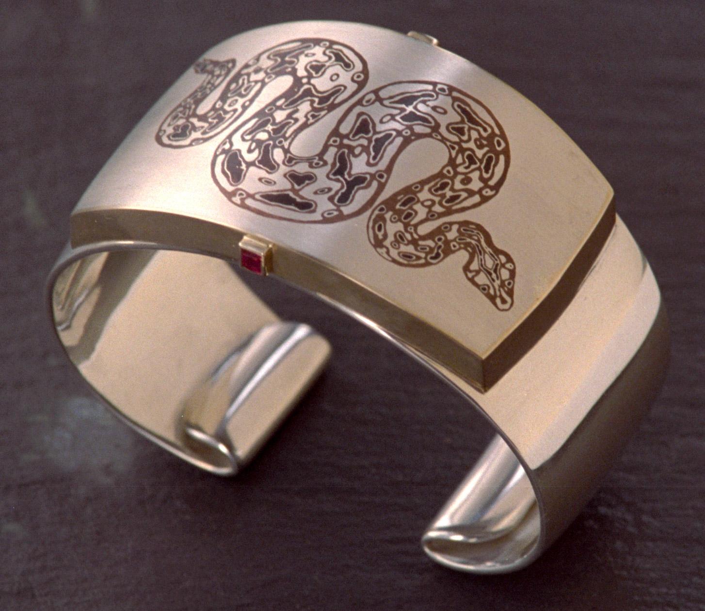 """""""Snake Bracelet"""" by Steve Midgett. Sterling, copper, shakudo and 14K with rubies."""