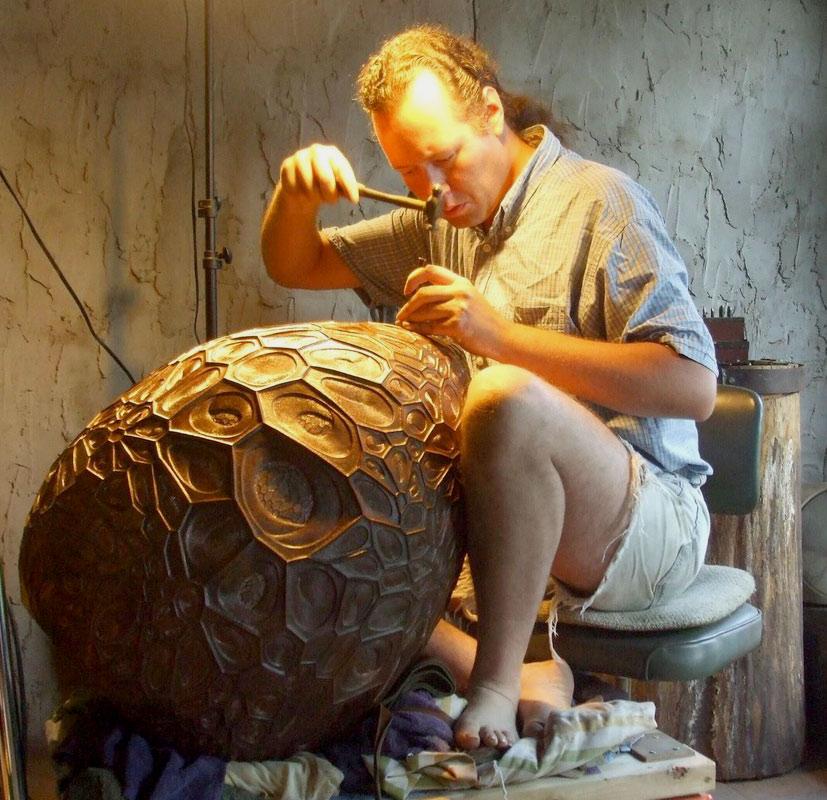 David Huang chasing a huge copper vessel in his studio.