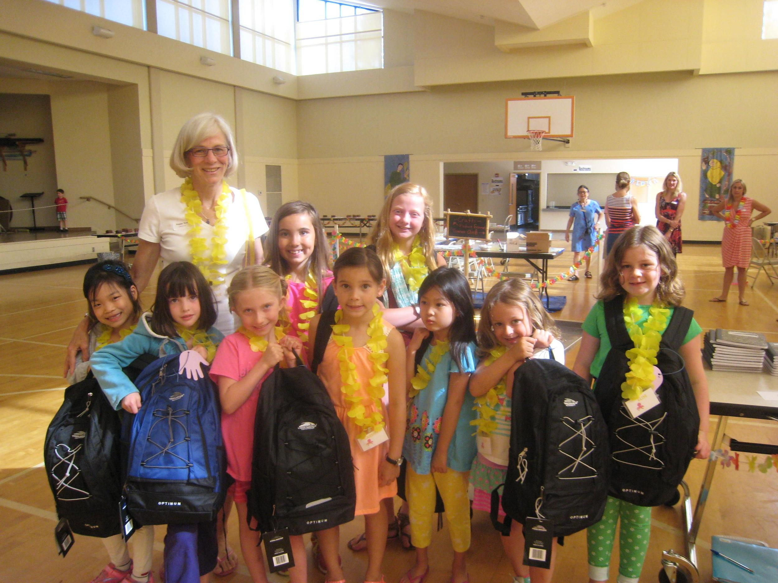 Peggy Sue Juergens and her VBS team finish filling backpacks for MIPC's mission partner.