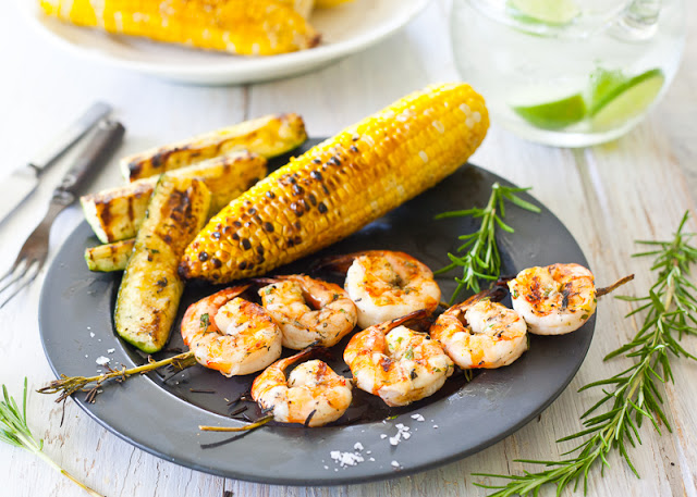 Shrimp grilled on rosemary branches