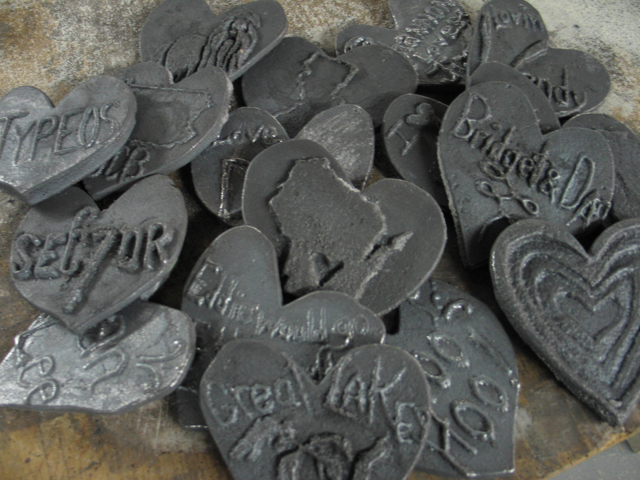 Examples of past hearts carved from sand moulds