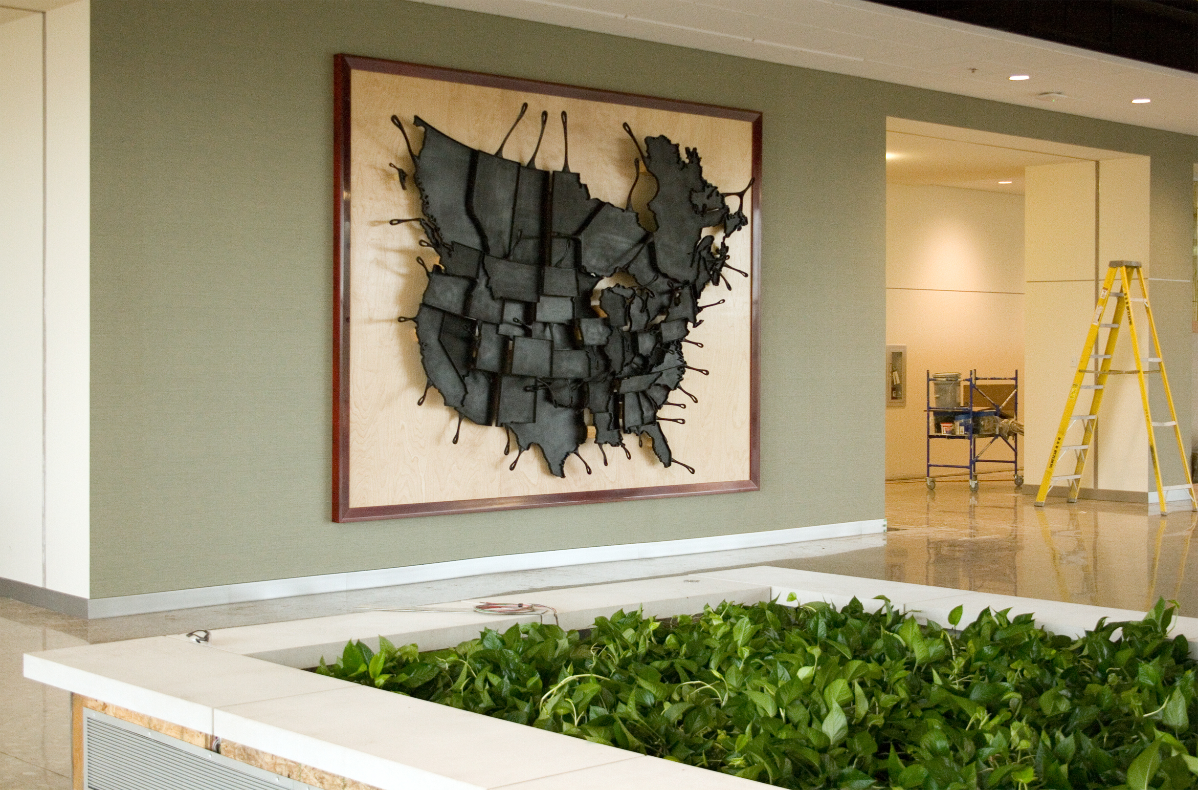 """"""" Made In North America """" (2012)  Gordon Foods Headquarters, Wyoming, Michigan.  12ft x 9ft composition of USA & Canada as skillets.  Materials: urethane REN board, birch ply, soft maple frame, custom stain, enamel black."""