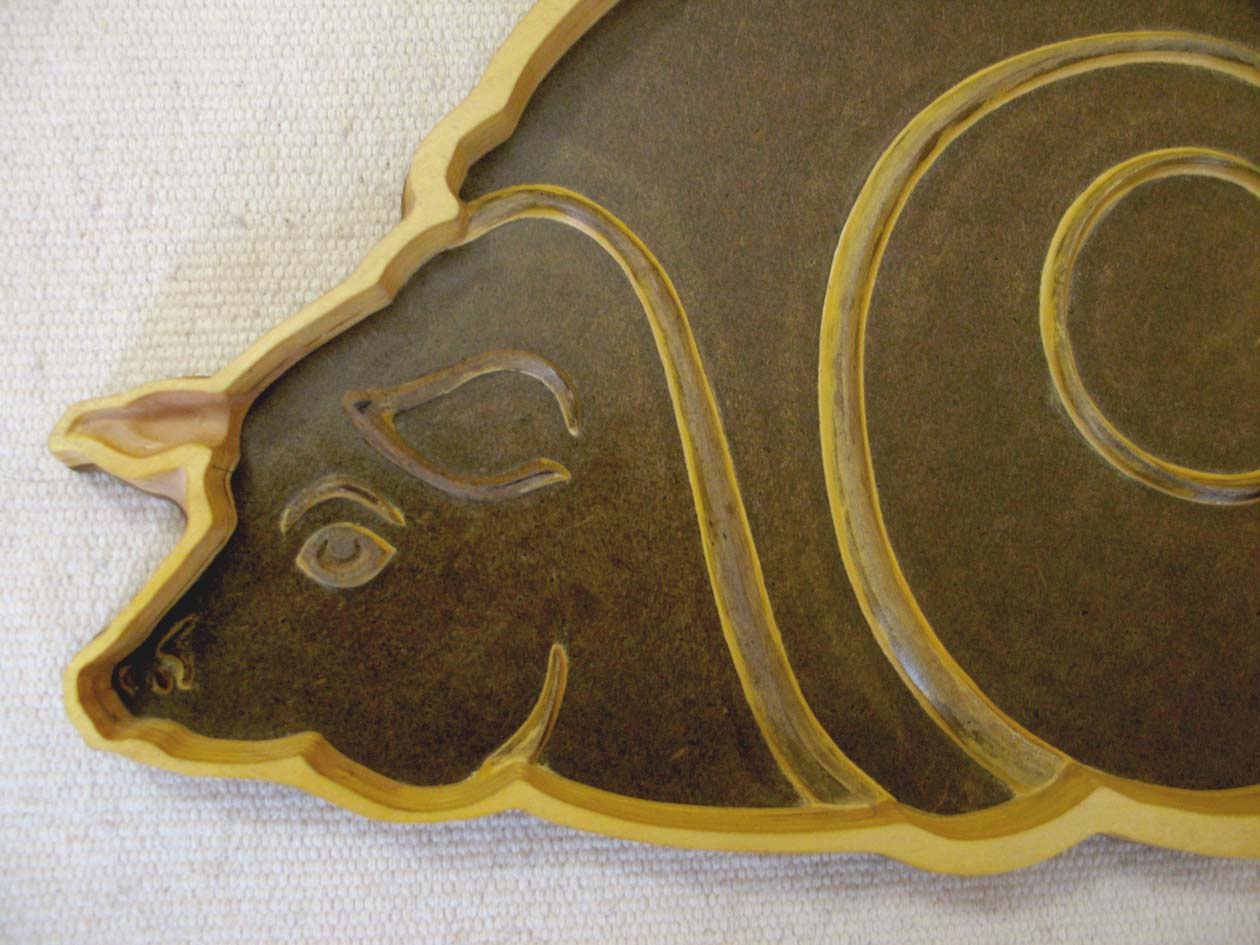 """Custom cast iron """" Slo Pig """" skillet, starts with a hand made wooden pattern, resembling the Slo Pig logo."""