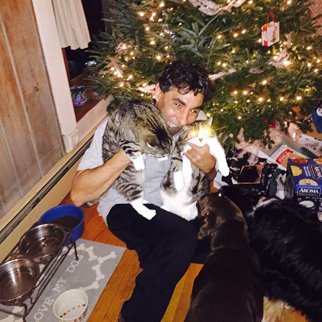 My husband with our furry babies Christmas morning! Happy new year !
