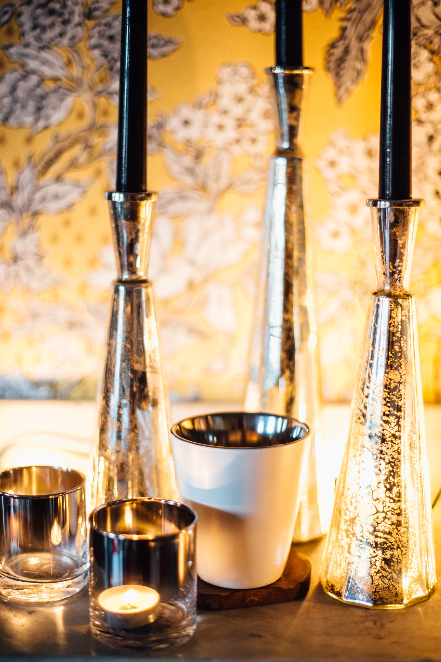 Black candles looked so chic against the black detail in the wallpaper. Gold and rose gold candles disappeared. The glass votives & candle holders are from West Elm, and the white silver-lined votive in the middle is from Hudson. Olivewood coasters is also from West Elm.