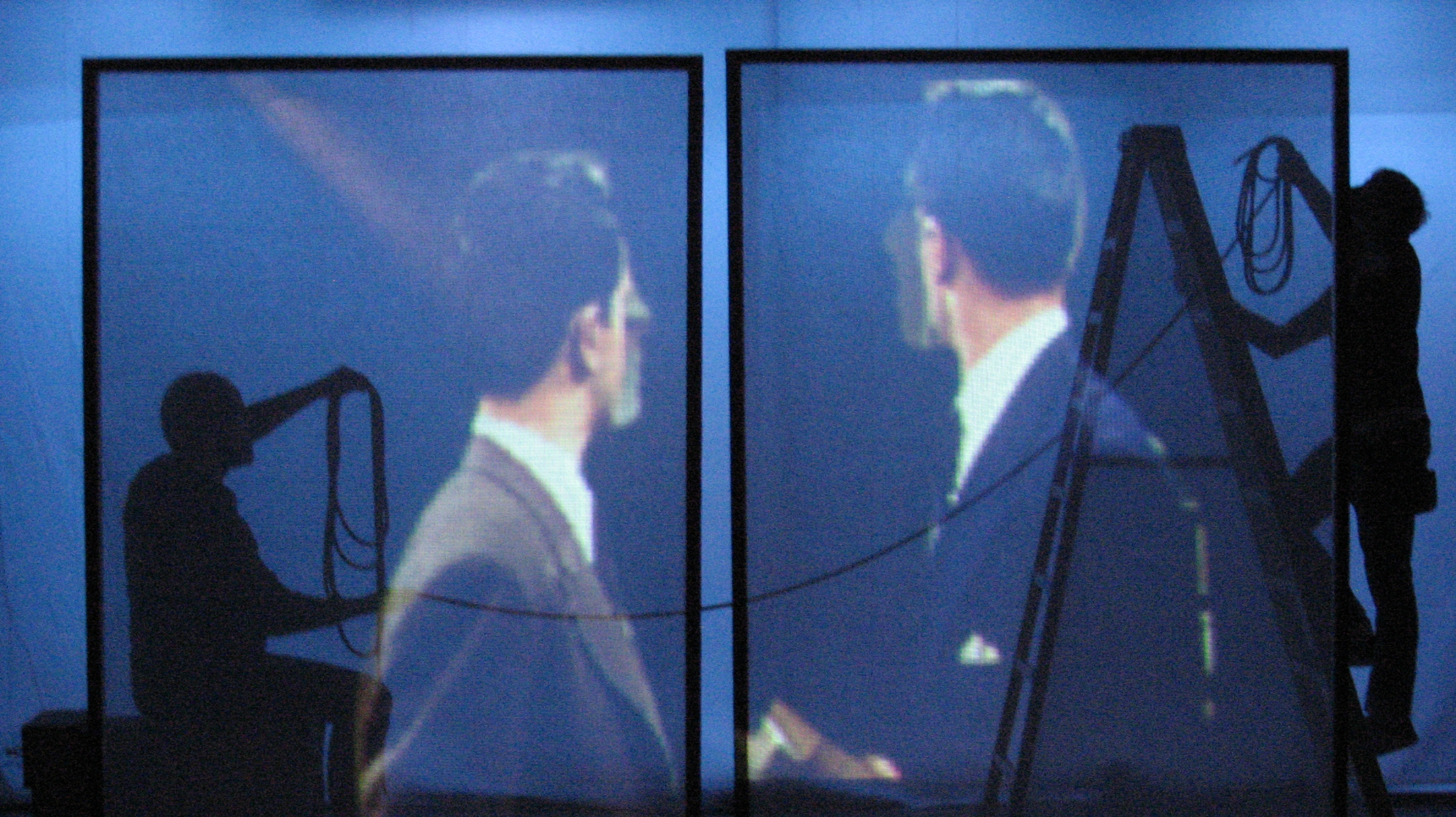 "In Farrington's  Gin & ""It""  his video theater work mirrors the technical feats of Hitchcock's daring film experiment in  Rope  with its own boundary-pushing melding of projected imagery and live drama. His first effort  The Passion Project  was a hybrid film theater installation piece that was acclaimed for its inventive take on the 1928 archival silent film masterpiece  The Passion of Joan of Arc  by Carl Theodore Dreyer.   Photo Credit: Reid Farrington"