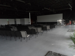 AJ Development is committed to value. By stripping and resealing the floors and painting the ceilings black, we created a pleasant, non-distracting theater environment while keeping costs at a minimum.