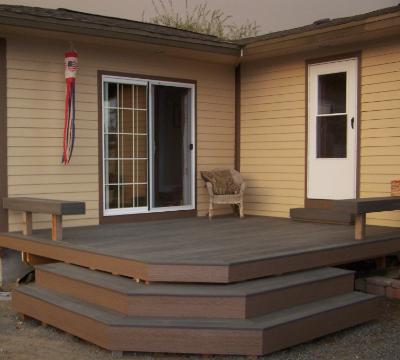 There was once a poorly constructed cinderblock patio here, but now there is a custom deck was built in its place, complete with built-in benches. A much more functional and beautiful look!