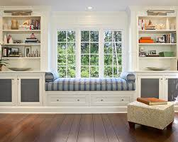 Beautiful window seat with storage and shelving make this an inviting space