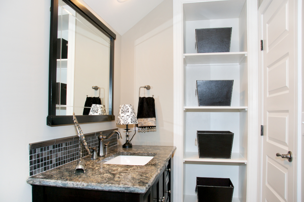 Custom built-ins were added to this previously wasted space behind the door.
