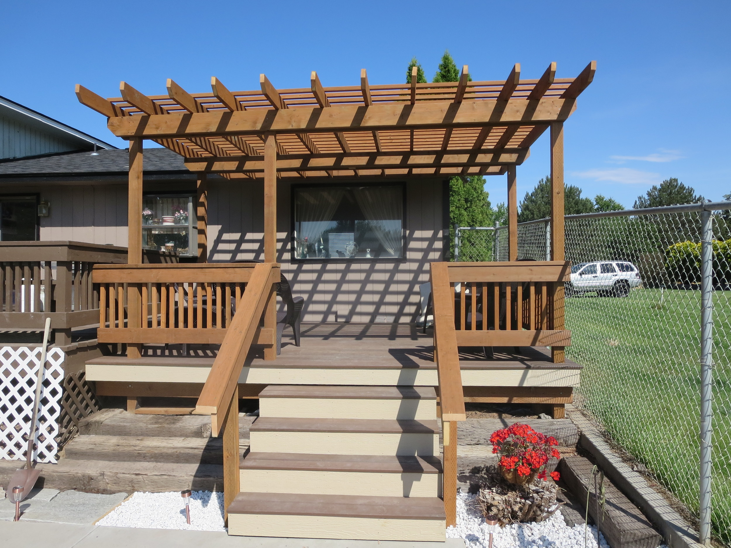 A brand new deck and pergola were constructed for enjoying the Tri-City summer days in this homeowner's backyard!