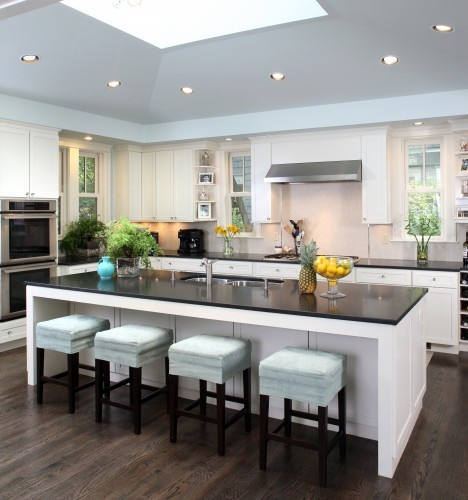 This kitchen utilizes an island to provide extra seating and countertop area