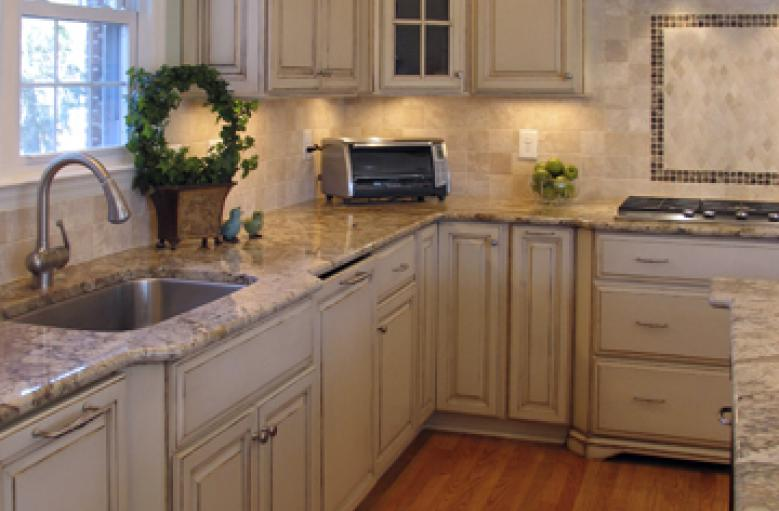 Custom made fronts for the appliances that match the kitchen cabinets