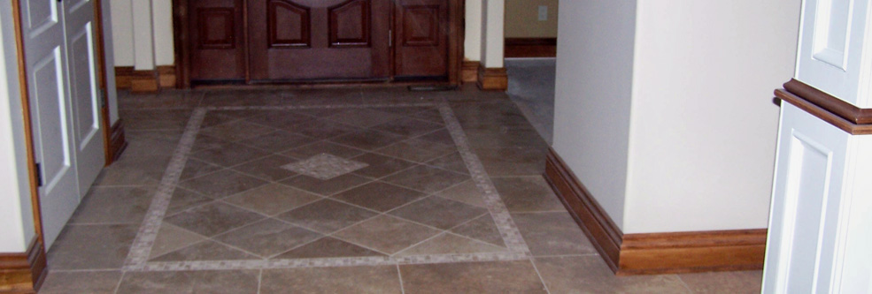 Floor tile pattern adds elegance to this entryway